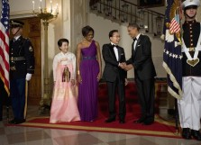U.S. President Obama shakes hands with South Korean President Lee as their wives look on at a state dinner at the White House