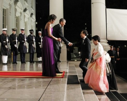 U.S. President Obama and South Korean President Lee arrive for a state dinner with their wives at the White House