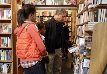 President Barack Obama with his daughters visit Kramerbooks