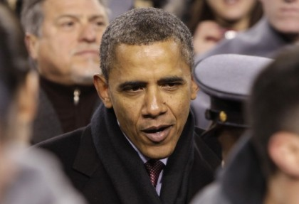 U.S. President Barack Obama talks to an army cadet during the 2011 Army vs Navy football game in Landover