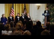 US President Barack Obama (R) speaks as