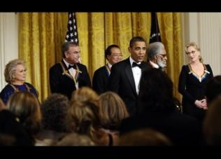 US President Barack Obama greets Kennedy