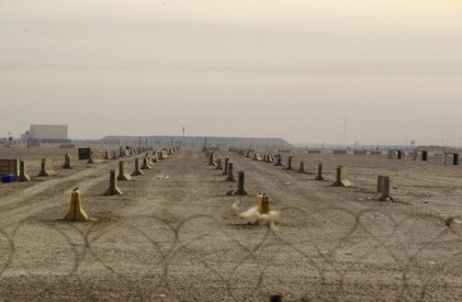An empty lot stands behind barbed wire inside Camp Adder, the last United States base in Iraq, near Nasiriyah