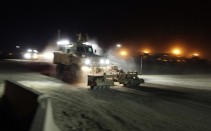Soldiers from the 3rd Brigade Combat Team, 1st Cavalry Division depart Camp Adder in their Mine Resistant Ambush Protected vehicles (MRAP) as part of the last U.S. military convoy to leave the country near Nasiriyah, Iraq