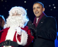 U.S. President Barack Obama sings a Christmas carol with Santa Claus during the lighting of the National Christmas Tree