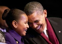 US President Obama and his daughter Sasha laugh during the lighting of the National Christmas Tree in Washington