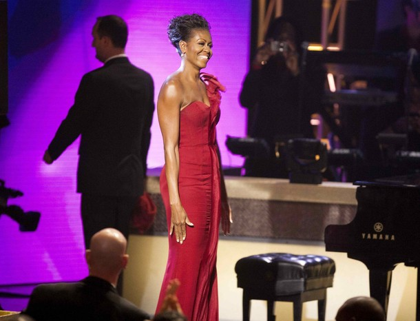 U.S. first lady Michelle Obama smiles as she departs the BET Awards in Washington