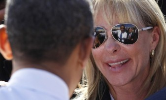 U.S. President Barack Obama is reflected in sunglasses at a UPS facility in Las Vegas