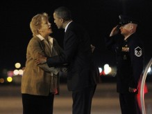 U.S. President Obama is greeted by Las Vegas Mayor Goodman upon his arrival at Las Vegas Airport