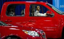 US President Barack Obama sits inside a
