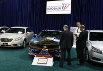 U.S. President Barack Obama tours the 2012 Washington Auto Show in Washington
