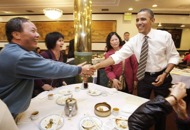 U S President Barack Obama Greets Diners During A Stop At