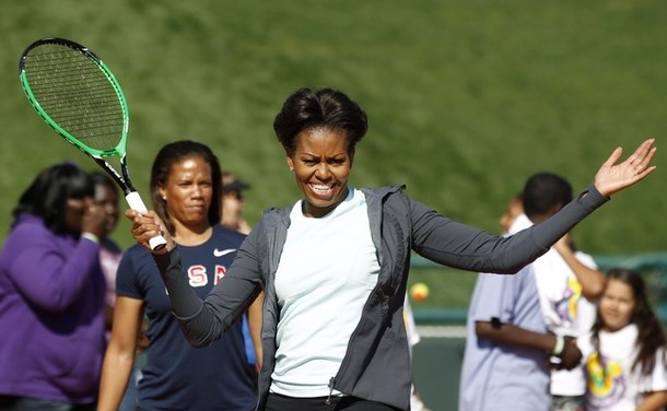"U.S. First Lady Michelle Obama plays mini-tennis during a ""Let's Move!"" faith and communities physical activity in Orlando"