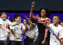 "U.S. First Lady Michelle Obama performs the Interlude dance during an event highlighting her ""Let's Move"" initiative in Des Moines"