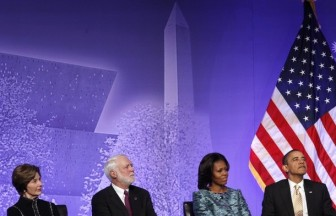 Former first lady Bush, Smithsonian Secretary Clough, first lady Michelle and U.S. President Obama attend the ground breaking ceremony for the Smithsonian National Museum of African American History and Culture in Washington