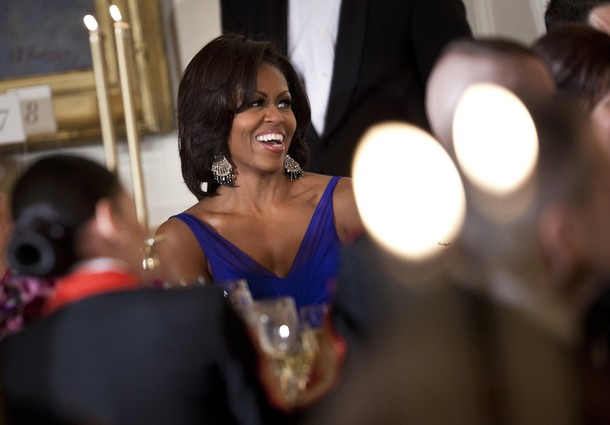 US first lady Michelle Obama laughs at a