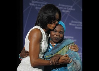 U.S. First lady Michelle Obama embraces Hawa Abdallah Mohammed Salih of Sudan during the State Department's 2012 International Women of Courage Award winners ceremony in Washington