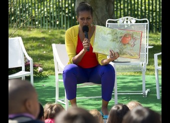 First Lady Michelle Obama reads a book t