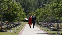 U.S. President Obama and first lady Michelle Obama walk while paying respects to fallen soldiers at Fort Stewart in Georgia