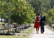 U.S. President Obama and first lady Michelle Obama pay respects to fallen soldiers at Fort Stewart in Georgia