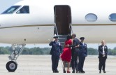 US President Barack Obama kisses First L
