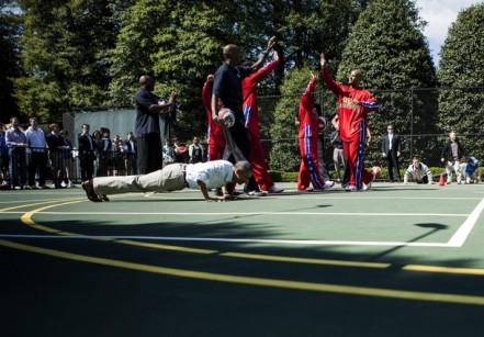 US President Barack Obama does pushups w