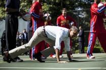 US President Barack Obama gets up after