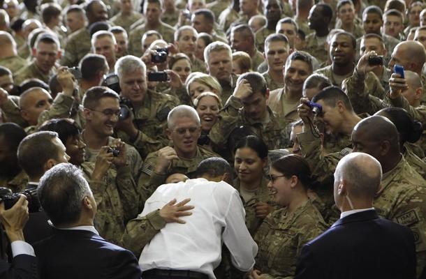 U.S. President Barack Obama gets a hug as he greets troops at Bagram Air Base in Kabul