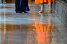 President Barack Obama and US Secretary of State Hillary Clinton wearing no shoes listen to dean of the Faculty of Buddhism, Chaokun Suthee Thammanuwat , during a tour at the Wat Pho Royal Monastery in Bangkok on No