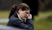 A mourner leaves the funeral of Jack Pinto one of the 26 who died at Sandy Hook school