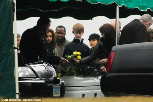 Friends and family- Those who knew Jack Pinto lay flowers on the youngster's casket at Newtown Village Cemetery