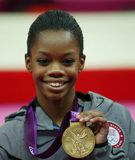 Gold medallist Gabrielle Douglas of the U.S. holds her medal after the women's individual all-around gymnastics final during the London 2012 Olympic Games