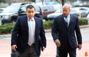George Zimmerman, left, arrives at the Seminole County courthouse for a hearing, Tuesday, December 11, 2012.