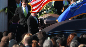 Pall bearers carrying the coffin of Victoria Soto, a Sandy Hook schoolteacher, at Lordship Community Church, where an overflow crowd attended her funeral service on Wednesday.