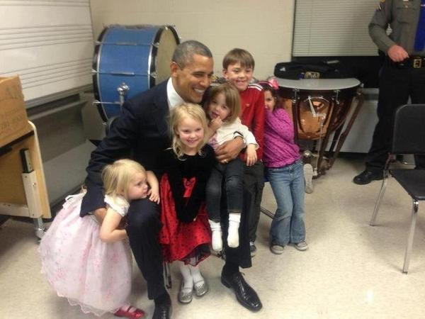 President Obama playing with those who lost their siblings