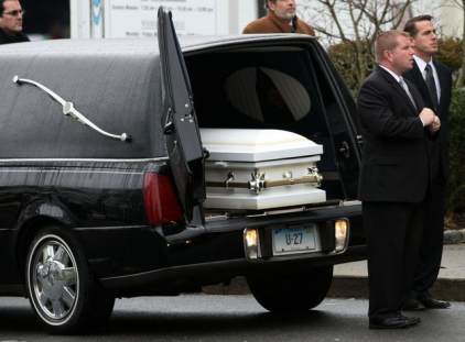 The casket carrying the body of Sandy Hook Elementary School student Jessica Rekos, 6, waits to be carried into the St. Rose of Lima Church for funeral services in Newtown, Connecticut