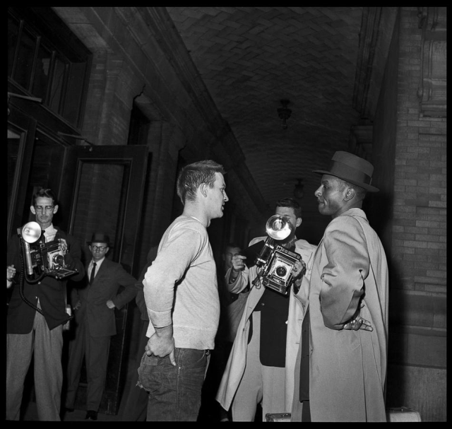 Freedom Riders - The Rev. Fred Shuttlesworth, right, is stopped before entering the whites only waiting room at the Bus Terminal March 6, 1957, in Birmingham, Ala
