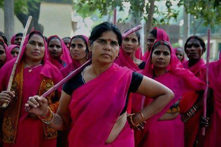 Indian women with bamboo sticks. They protect other women.