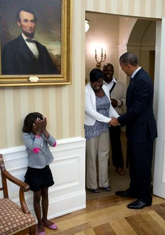 Janiya Penny reacts after meeting President Barack Obama as he welcomes her family to the Oval Office