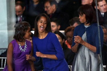 Malia Obama  dances on the reviewing stand
