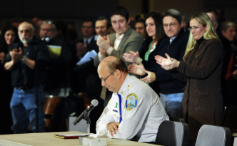 Newtown Gun Control Hearing-Newtown Chief of Police Michael Kehoe receives a standing ovation from families of the victims of the Sandy Hook Elementary School shooting during a hearing to a legislative task force on gun violence
