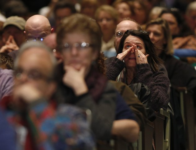 Newtown Gun Control Hearing- People react as they sit and watch families of Sandy Hook shooting victims testify at a public hearing on gun control