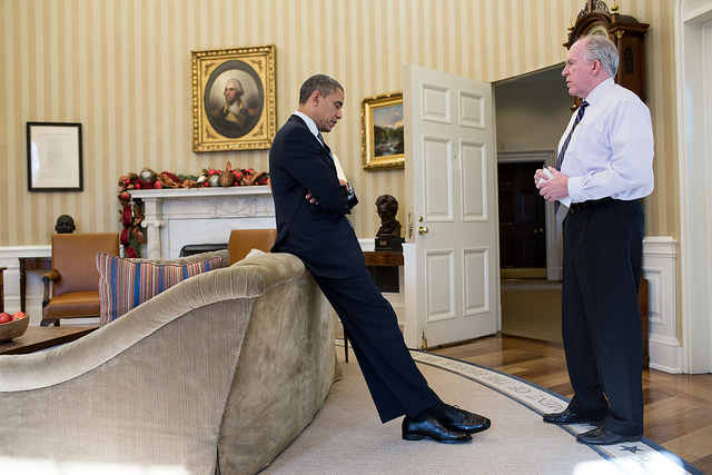 President Obama reacts as John Brennan briefs him on the details of the shootings at Sandy Hook Elementary School in Newtown, Conn.