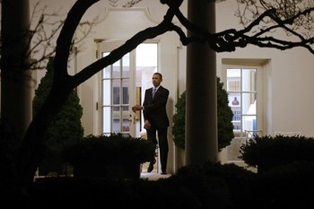 President Obama walks out of the Oval Office as he departs the White House in Washington on Tuesday, Jan. 1, 2013.