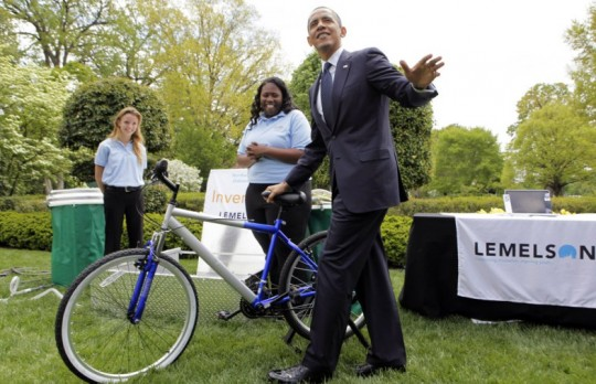 President Obama tries the bicycle-powered emergency water-sanitation station, created by high schoolers Payton Karr and Kiona Elliot from Oakland Park, Florida