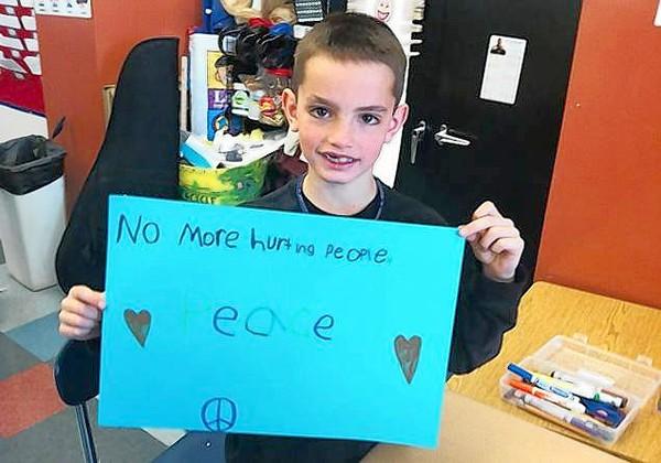 Photo shows boy killed in Boston Marathon attack commemorating Trayvon Martin