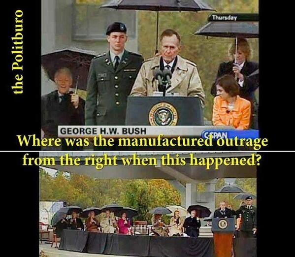 Bush with Marines holding umbrella1