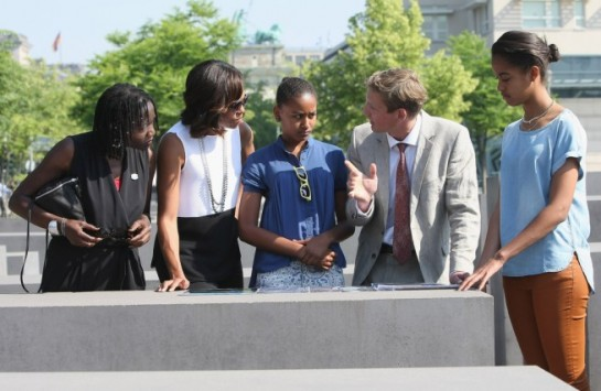 First Lady Michelle Obama visits the Memorial to the Murdered Jews of Europe with her husband's half sister, Auma Obama, her daughter Sasha, Uwe Neumaerker, director of the foundation for the memorial, and Obama's daughter Malia