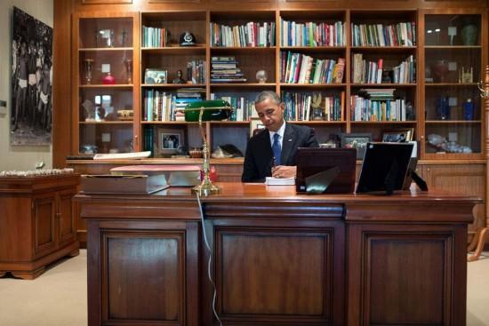 Pres Obama inscribes a book at Nelson Mandela's desk at the Nelson Mandela Centre of Memory in Johannesburg