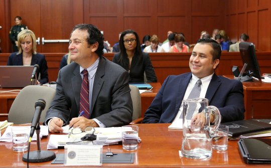 George Zimmerman smiling in court